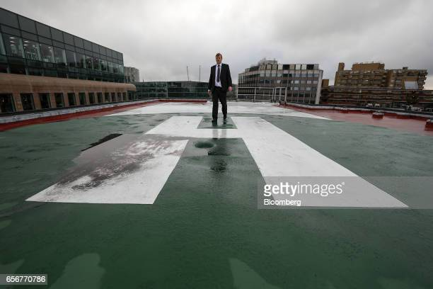 Employees walk on the helipad landing zone at the De Beers SA headquarters on Charterhouse Street in London UK on Wednesday Feb 1 2017 Number 17...