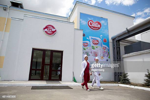 Employees walk out of the APU JSC dairy plant in Ulaanbaatar Mongolia on Tuesday June 24 2014 APU is Mongolia's largest spirit and beverage...