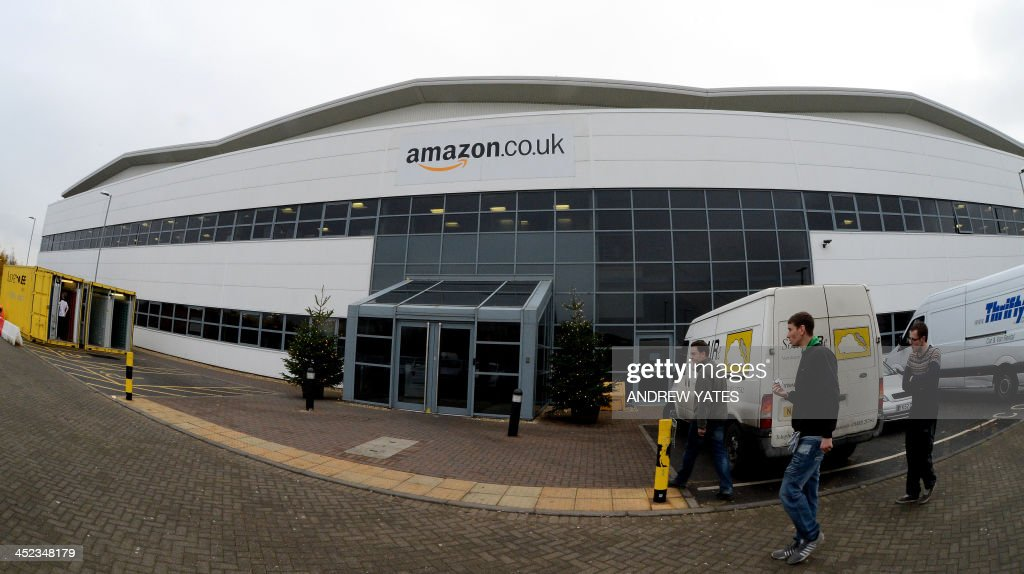 Employees walk outside the the Fulfilment Centre for online retail giant Amazon in Peterborough, central England, on November 28, 2013, ahead of Cyper Monday on December 2nd, expected to be one of the busiest online shopping days of the year.