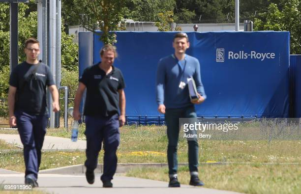 Employees walk through the grounds of the plant producing the RollsRoyce Trent XWB airplane engine to be used in the Airbus A350 XWB aircraft on June...