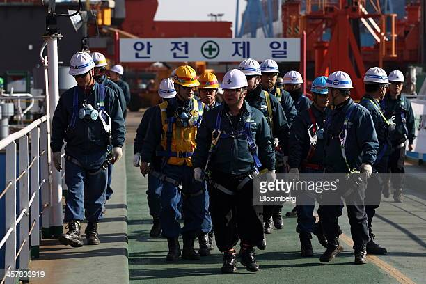 Employees walk through the Hyundai Samho Heavy Industries Co shipyard an affiliate of Hyundai Heavy Industries Co in Yeongam South Korea on Wednesday...