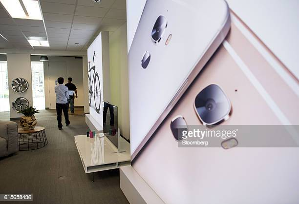 Employees walk through the lobby of the LeEco Global Group headquarters in San Jose California US on Thursday Oct 13 2016 LeEco is bringing its...