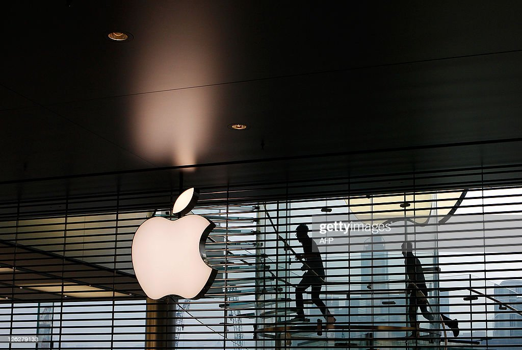 Employees walk up a flight of stairs prior to the opening of the first Apple retail store in Hong Kong on September 24, 2011. Apple opened its first store in Hong Kong on September 24, part of its plan to tap into the booming China market. AFP PHOTO / Dale de la Rey