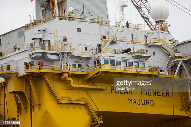 Employees watch ShellNo flotilla protestors from aboard Royal Dutch Shell's Polar Pioneer oil drilling rig during demonstrations against Royal Dutch...