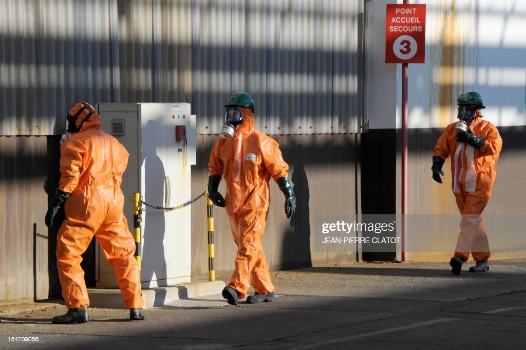 Employees wearing protection suits are seen during a security exercice in Jarrie, southeastern France inside the Jarrie site of CEZUS, an AREVA group subsidiary and a global leader in the market for nuclear-grade zirconium. Zirconium is a metal used for fuel cladding, among other applications. The CEZUS Jarrie plant site produces zirconium sponge through a series of chemical operations and extractive metallurgy. It also recovers the by-products of zirconium manufacturing , such as hafnium, magnesium and silicon salts and oxides. AFP PHOTO / JEAN-PIERRE CLATOT