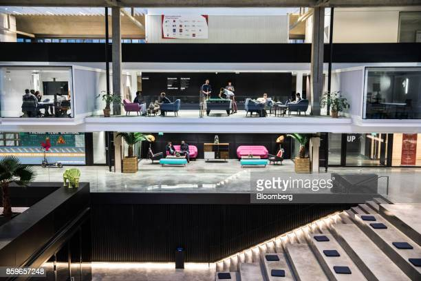 Employees work and play pool in illuminated workspace cubicles inside in the Station F startup campus in Paris France on Monday Oct 2 2017 Better...