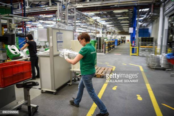 Employees work at a production plant of German group VorwerkSemco where the Thermomix kitchen foodprocessor is manufactured on May 19 2017 in...