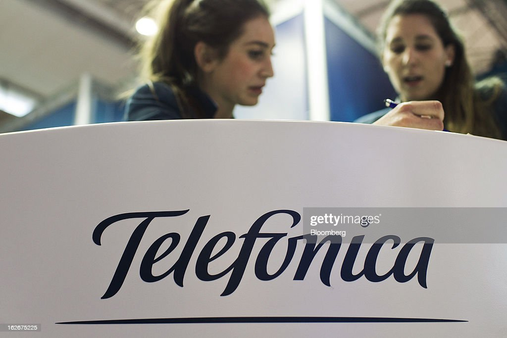 Employees work at a service desk in the Telefonica SA pavilion at the Mobile World Congress in Barcelona, Spain, on Monday, Feb. 25, 2013. The Mobile World Congress, where 1,500 exhibitors converge to discuss the future of wireless communication, is a global showcase for the mobile technology industry and runs from Feb. 25 through Feb. 28. Photographer: Angel Navarrete/Bloomberg via Getty Images