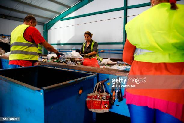 Employees work at a waste management plant in Geri on the outskirts of the Cypriot capital Nicosia on October 5 2017 / AFP PHOTO / Florian CHOBLET