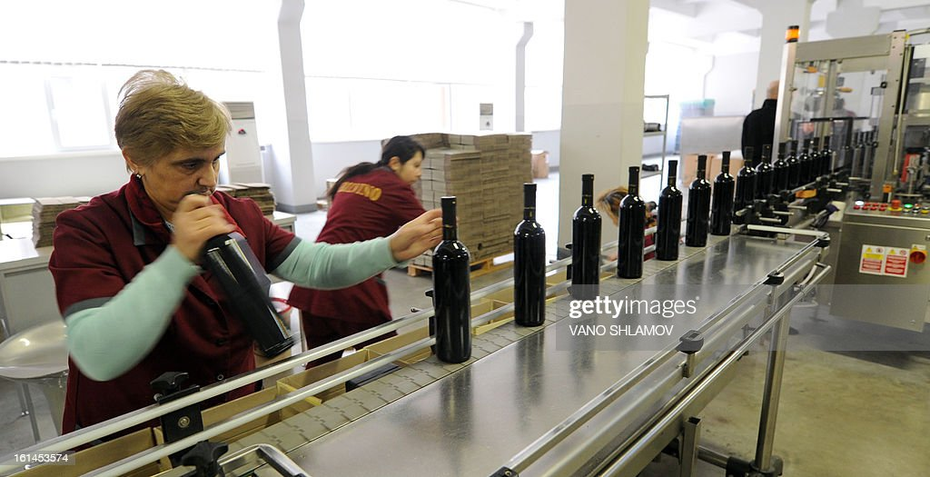 Employees work at a winery in Tbilisi, on February 11, 2013. Georgian officials held recently talks in Moscow to agree a mechanism on lifting the Russian trade embargo on Georgian wine and mineral water.