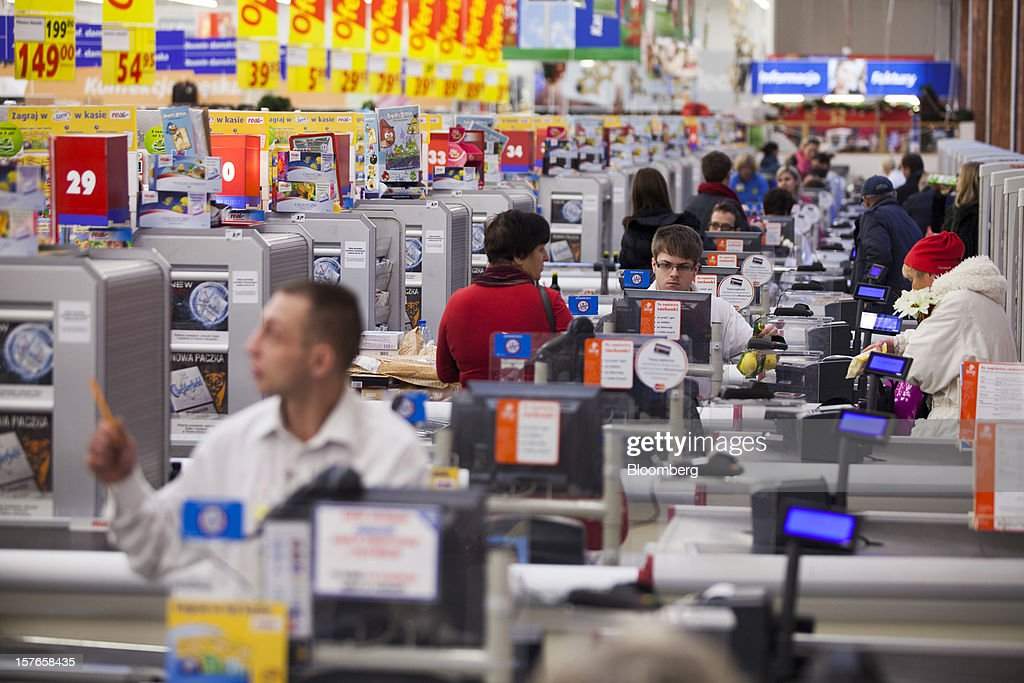 Employees work at checkout desks inside a Real supermarket in Wroclaw, Poland, on Wednesday, Dec. 5, 2012. Metro AG, Germany's biggest retailer, agreed to sell its Real grocery stores in eastern Europe to Groupe Auchan SA of France for 1.1 billion euros ($1.4 billion) in Chief Executive Officer Olaf Koch's first big deal since taking the helm. Photographer: Bartek Sadowski/Bloomberg via Getty Images