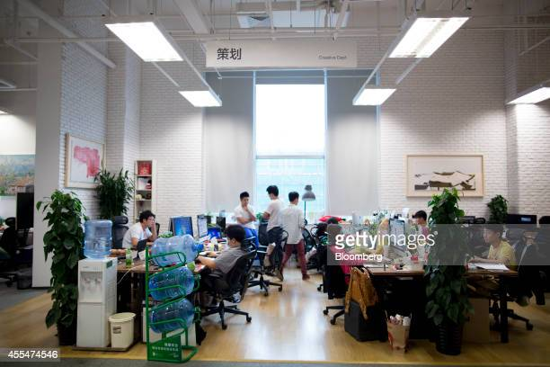 Employees work at computers in the Creative Department inside a Xiaomi Corp office in Beijing China on Friday Sept 12 2014 Xiaomi Chief Executive...
