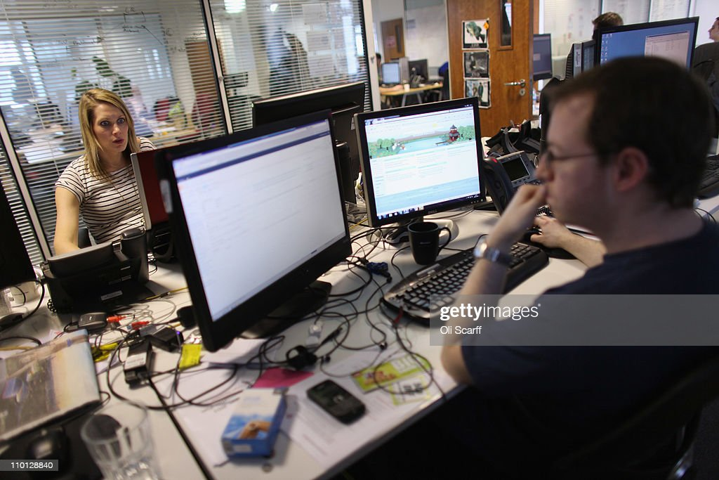 Employees work at computers in the office of 'Content and Code' on the Old Street roundabout in Shoreditch which has been dubbed 'Silicon Roundabout' due to the number of technology companies operating from the area on March 15, 2011 in London, England. Content and Code are a technology consultancy company and Microsoft partner. The relatively low rental rates and proximity to media and internet companies has made the area close to the roundabout a prime location for IT firms and web entrepreneurs.