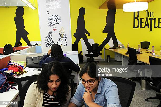 Employees work at desks in the office of Myntracom a unit of Flipkart Internet Services Pvt in Bangaluru India on Friday Dec 04 2015 Discounts and...