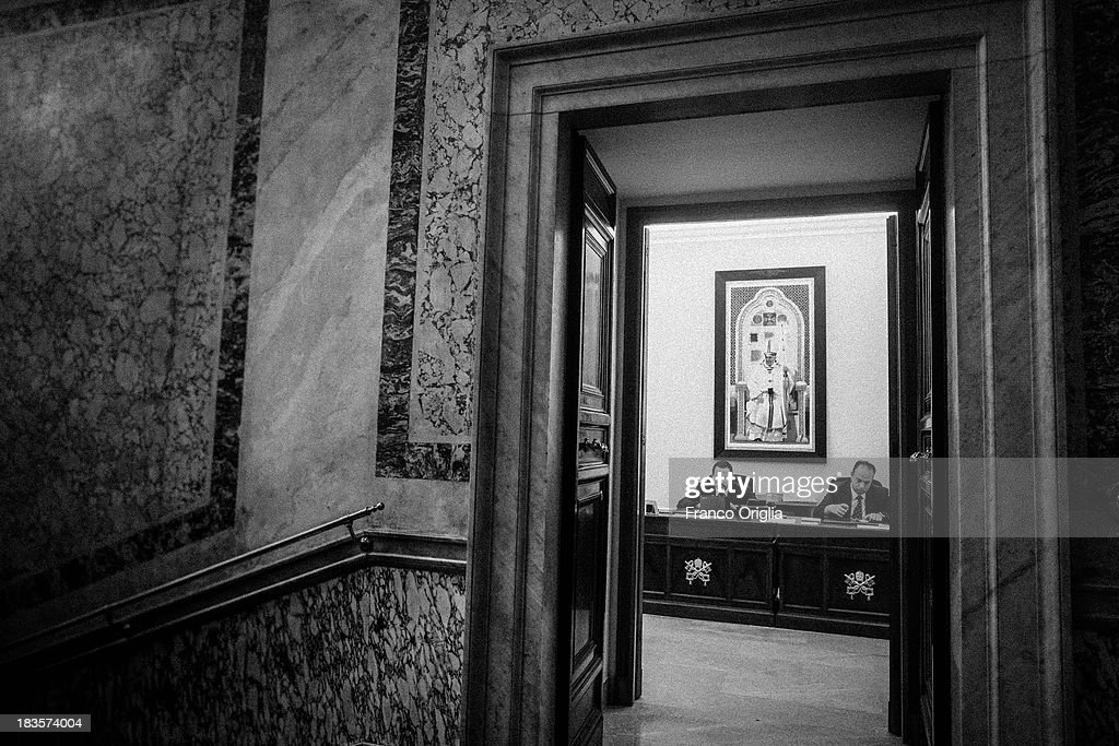 Employees work at the desk of the Vatican Prefecture in the Apostolic Palace on October 7, 2013 in Vatican City, Vatican. After the success of his Social networking accounts of Twitter and Facebook, Pope Francis joined Instagram, reporting today more than 8000 followers.
