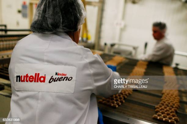 Employees work at the Ferrero plant in VillersEcalles northwestern France on January 27 2017 The Ferrero plant of VillersEcalles is the biggest plant...