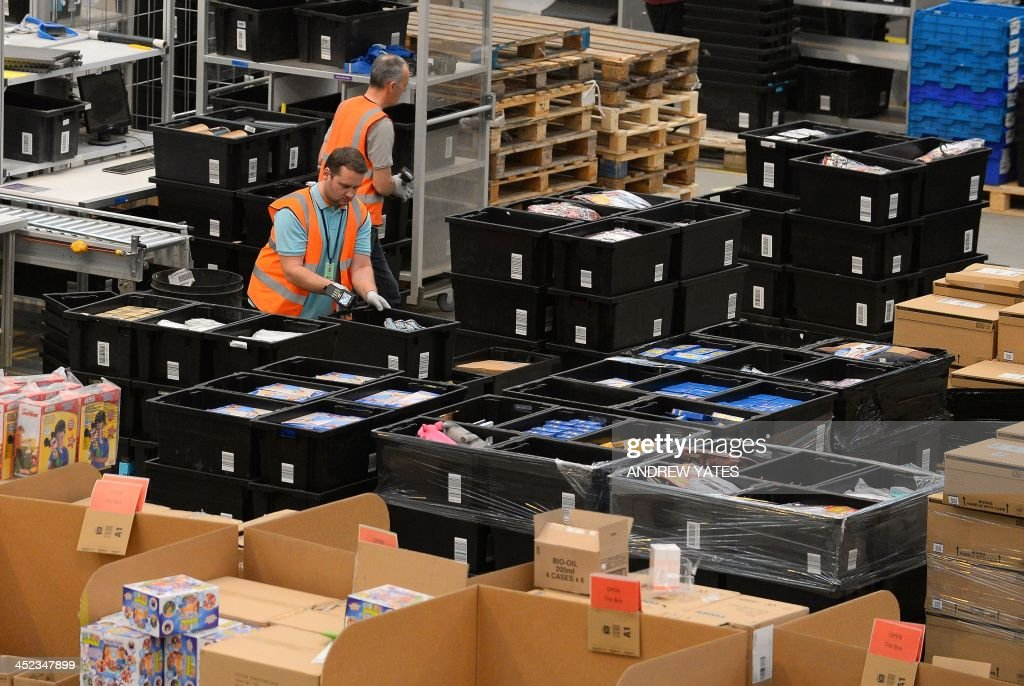 Employees work at the Fulfilment Centre for online retail giant Amazon in Peterborough, central England, on November 28, 2013, ahead of Cyper Monday on December 2nd, expected to be one of the busiest online shopping days of the year.