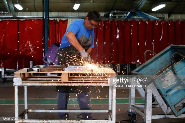 Employees work at the GMS car parts manufacturer site as employees resume work on May 29 2017 in La Souterraine central France Around 280 jobs are on...
