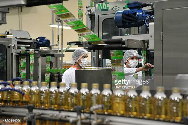 Employees work at the Indonesian food and beverage company PT ABC President Indonesia bottled tea beverage drink product manufacturing plant in...