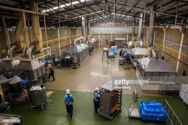 Employees work at the Nithi Foods Co factory in the San Pa Tong district of Chiang Mai Thailand on Tuesday May 23 2017 Thailand's consumer prices...