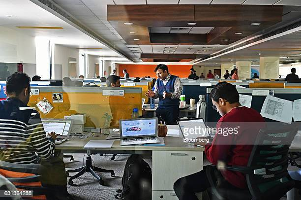 Employees work at the office of PayTM a unit of One97 Communications Ltd in Noida Uttar Pradesh India on Wednesday Dec 14 2016 India's largest...