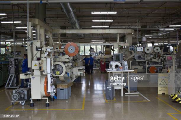 Employees work at the Philip Morris International Coltabaco SAS production factory in Medellin Colombia on Friday June 2 2017 Philip Morris...