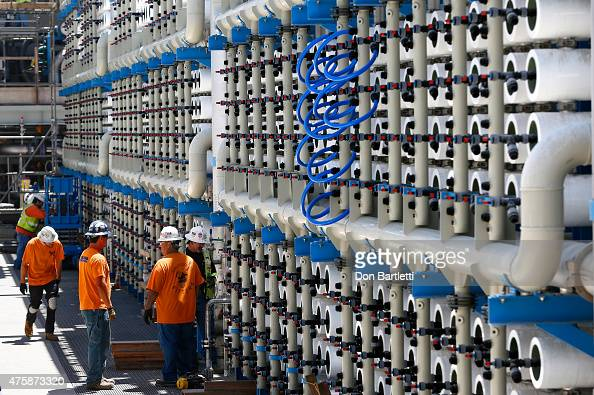 Employees work at the Poseidon Water desalination plant April 30 2015 in Carlsbad California The plant is an interconnected system of 2500 reverse...