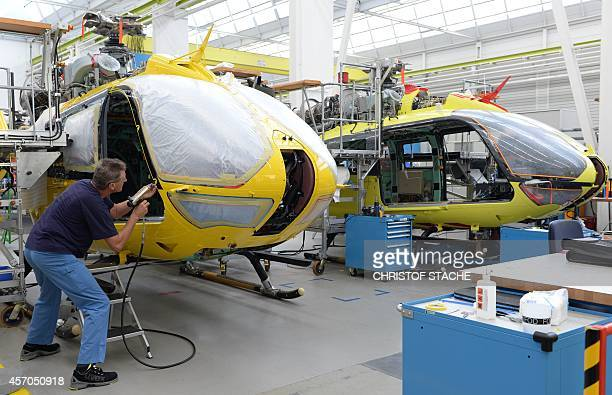 Employees work at the production line of Airbus helicopters at the plant in Donauwoerth southern Germany on October 9 2014 AFP PHOTO/CHRISTOF STACHE
