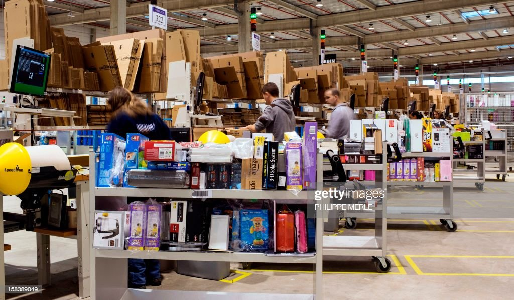 Employees work at the site of the online retailer Amazon on December 13, 2012 in Chalon-sur-Saone, centraleastern France.