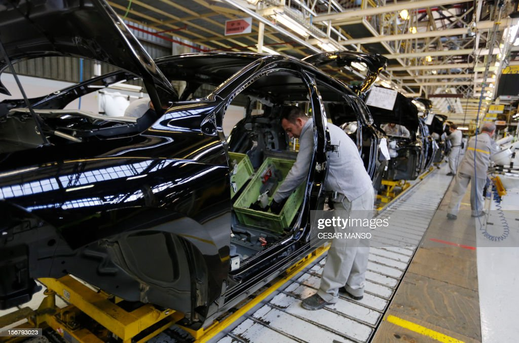 Employees work at the Villamuriel Renault factory in northern Spain on November 21, 2012. French car maker Renault plans to create 1,300 jobs at its factories in recession-hit Spain, Spanish Prime Minister Mariano Rajoy said. The French giant, which employs 10,000 people at four sites in Spain, signed a deal on working conditions with Spanish labour unions last week but is still negotiating terms with workers in France as it seeks to be more competitive.