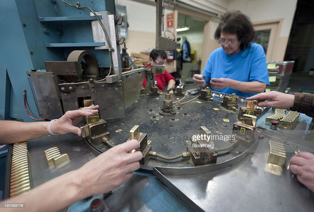 Employees work at the Zippo Manufacturing Co. plant in Bradford, Pennsylvania, U.S., on Tuesday, Jan. 17, 2012. The U.S. Federal Reserve is scheduled to release monthly industrial production figures on Jan. 18. Photographer: Paul Taggart/Bloomberg via Getty Images