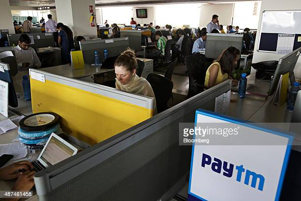 Employees work at their desks at the One97 Communications Ltd headquarters in Noida Uttar Pradesh India on Thursday May 14 2015 One97 which operates...