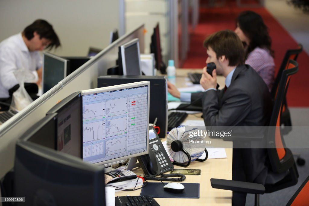 Employees work at their desks inside the Moscow Exchange in Moscow, Russia, on Thursday, Jan. 24, 2013. The Moscow Exchange, Russia's biggest bourse, plans to raise more than $500 million in an initial public offering, according to a person with knowledge of the matter. Photographer: Andrey Rudakov/Bloomberg via Getty Images