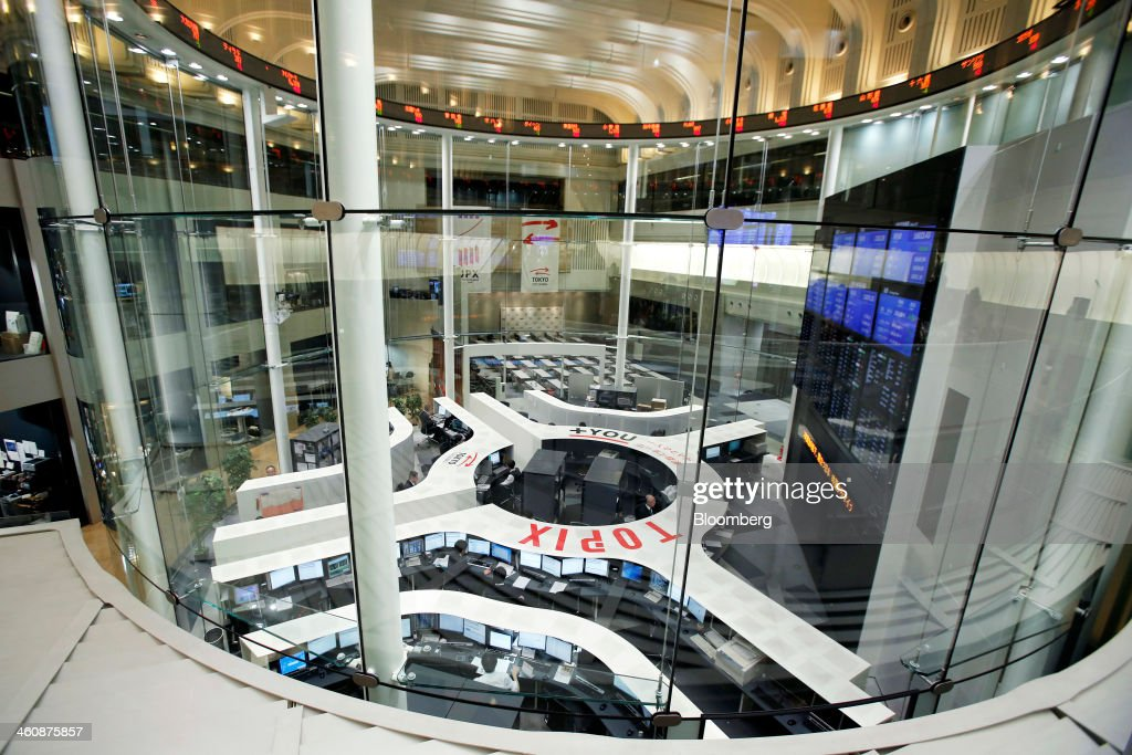 Employees work during the first trading day of the year at Japan Exchange Group Inc's Tokyo Stock Exchange in Tokyo Japan on Monday Jan 6 2014...
