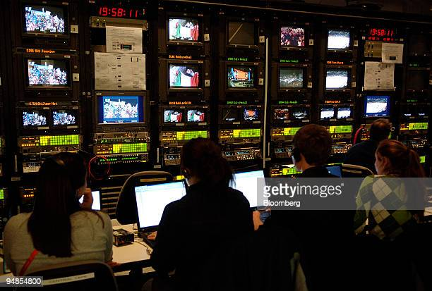 NBC employees work in a control room in the network's temporary studio at the 2006 Winter Olympics in Turin Italy Sunday February 12 2006