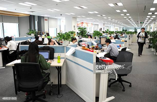 Employees work in an office of Sina Weibo widely known as China's version of Twitter in Beijing on April 16 Sina Weibo is set to go public in the US...