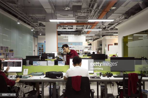 Employees work in front of computers at the Sinovation Ventures headquarters in Beijing China on Tuesday Aug 15 2017 Sinovation Ventures' latest...