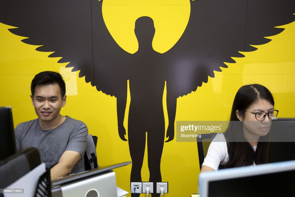 Employees work in front of computers at the Sinovation Ventures headquarters in Beijing, China, on Tuesday, Aug. 15, 2017. SinovationVentures' latest growing endeavor, an in-house AI Institute, has about 30 full-time employees with plans to grow headcount to about a hundred within the year. Photographer: Giulia Marchi/Bloomberg via Getty Images