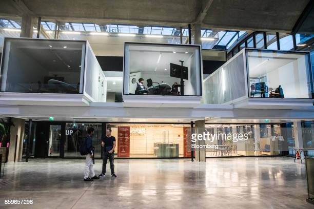 Employees work in illuminated workspace cubicles inside in the Station F startup campus in Paris France on Monday Oct 2 2017 Better known for being...