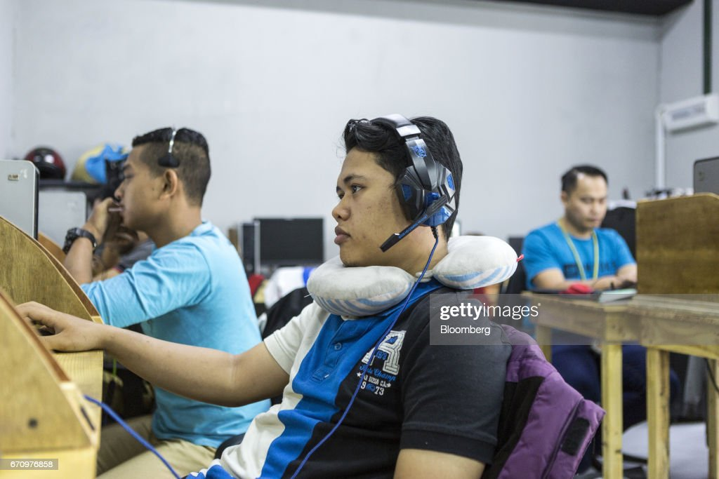 Employees work in the call center at Invoke's office in Kuala Lumpur, Malaysia, on Tuesday, April 18, 2017. Invoke is a policy research shop with about 80 employees set up last October by Rafizi Ramli, vice president of the opposition Peoples Justice Party, or PKR. He calls the data operation his secret weapon to oust Prime Minister Najib Razak in an election expected this year. Photographer: Charles Pertwee/Bloomberg via Getty Images