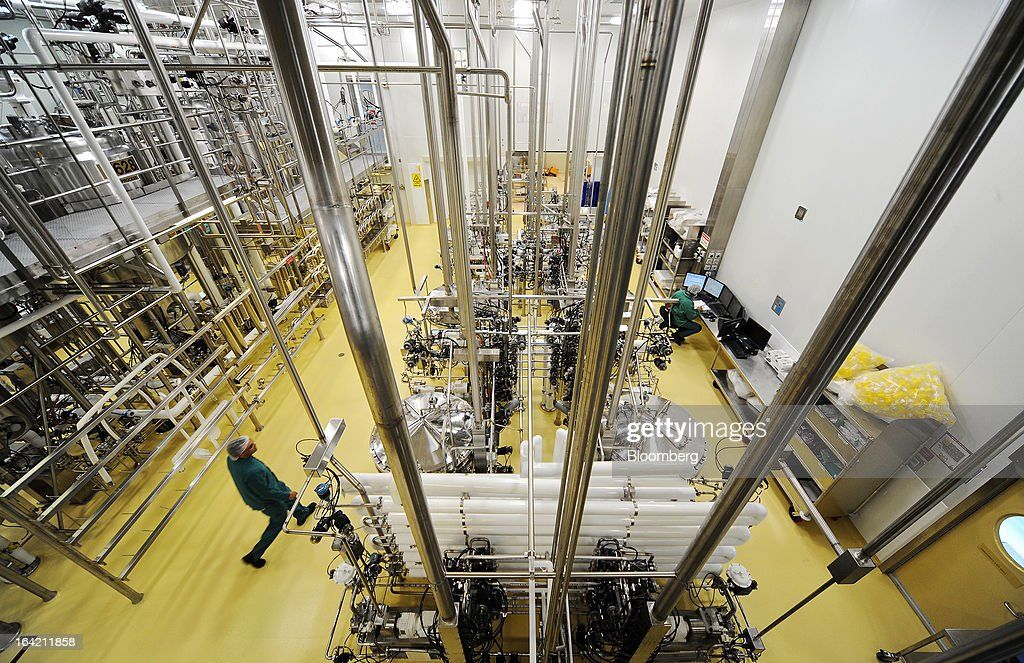 Employees work in the chromatography processing section of the CSL Behring plasma processing facility, a unit of CSL Ltd., in Melbourne, Australia, on Wednesday, March 20, 2013. CSL, the world's second-biggest maker of blood-derived therapies, is taking a hard look at its non-plasma businesses as incoming head Paul Perreault tries to assess their growth prospects. Photographer: Carla Gottgens/Bloomberg via Getty Images
