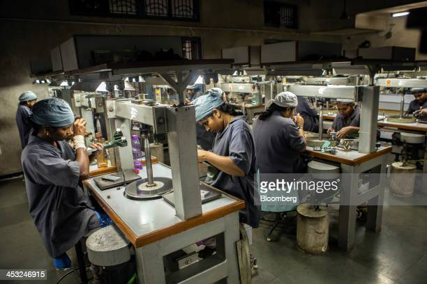 Employees work in the diamond cutting and polishing department at the Viswa Devji Diamonds Pvt factory in Coimbatore Tamil Nadu India on Thursday Nov...