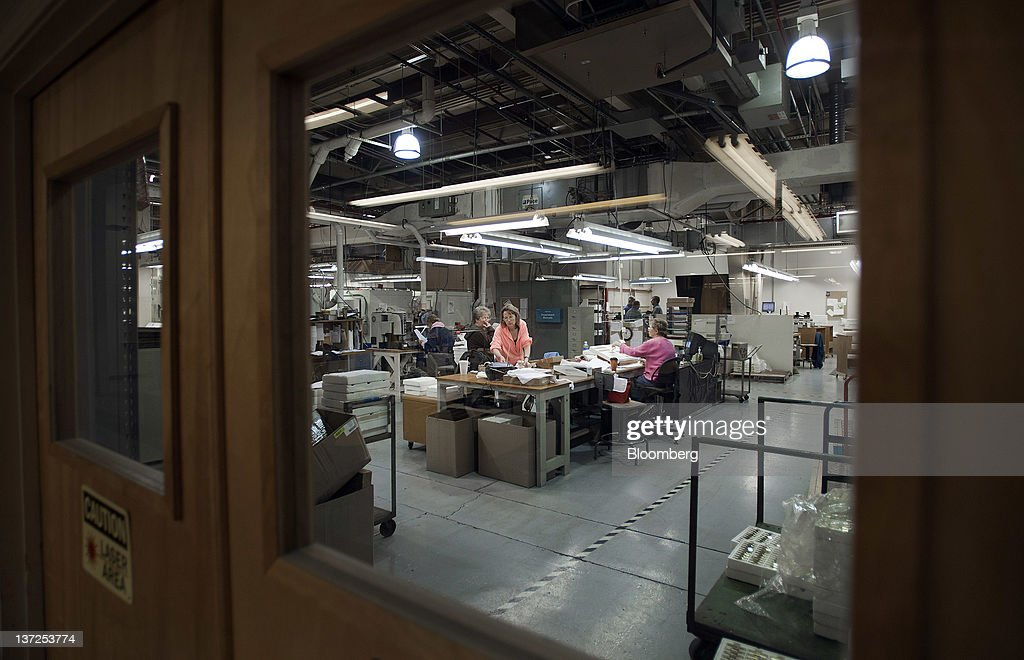Employees work in the engraving room of the Zippo Manufacturing Co. plant in Bradford, Pennsylvania, U.S., on Tuesday, Jan. 17, 2012. The U.S. Federal Reserve is scheduled to release monthly industrial production figures on Jan. 18. Photographer: Paul Taggart/Bloomberg via Getty Images