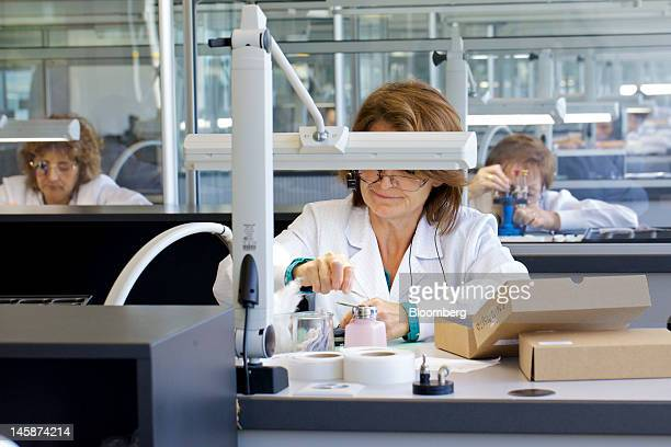 Employees work in the Hublot SA watchmaker's lab at the company's headquarters in Nyon Switzerland on Tuesday June 5 2012 Hublot SA Chairman...