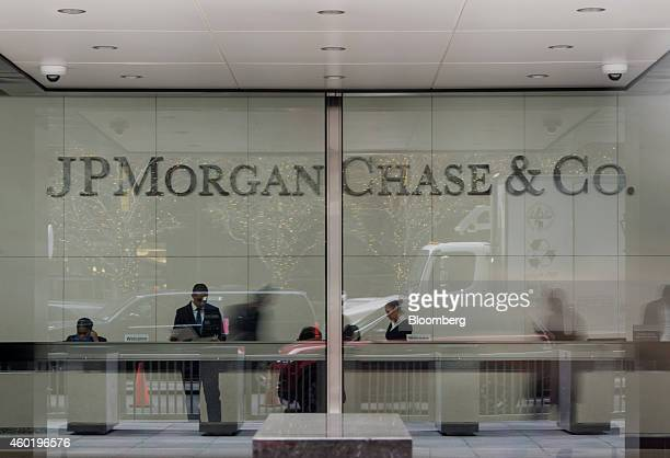 Employees work in the lobby of JPMorgan Chase Co headquarters in New York US on Monday Dec 8 2014 US stocks dropped following the worst loss in six...
