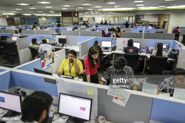 Employees work in the Think and Learn Pvt office in Bengaluru India on Wednesday April 5 2017 Online learning is exploding in India and no company is...