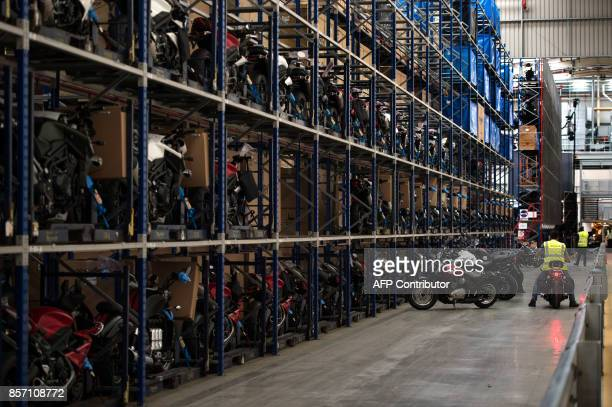 Employees work in the warehouse at the Triumph Motorcycles factory in Hinckley central England on October 2 2017 Triumph which was originally formed...