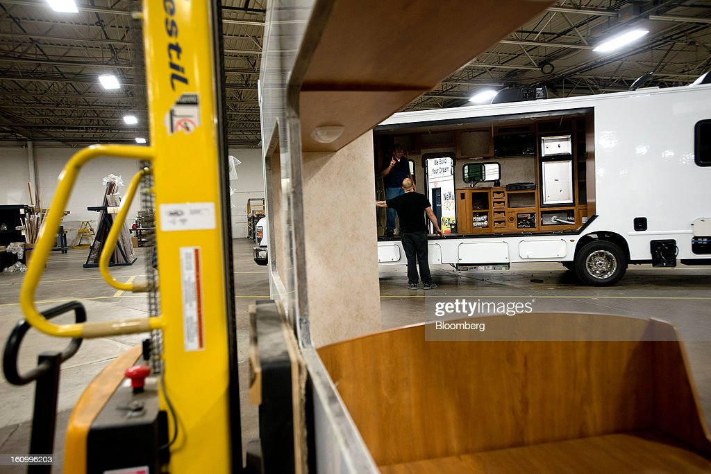 Employees work inside a Class C motorhome under construction at Nexus RV in Elkhart, Indiana, U.S., on Friday, Feb. 8, 2013. Orders placed with U.S. factories increased less than forecast in December, reflecting a drop in non-durable goods that partly countered gains in construction equipment and computers. Photographer: Ty Wright/Bloomberg via Getty Images