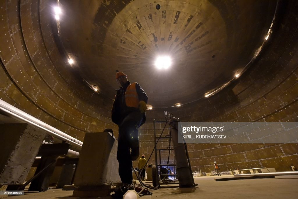 Employees work inside a natural gas reservoir under for Intranet interior