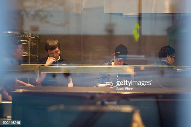 Employees work inside of Chipotle Mexican Grill seen at 1924 Beacon St on December 8 2015 in Boston Massachusetts According to Boston College...